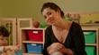 1of15 Children, educator, teacher eating in kindergarten, school
