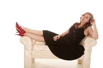 woman couch in black dress red shoes