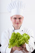 Young cook with lettuce