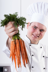 Smiling cook with carrots
