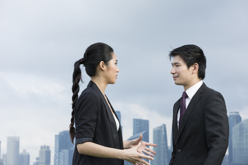 Portrait of asian business people talking outside