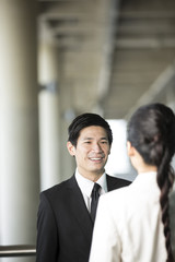 Asian Business colleagues talking