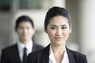 Asian businesswoman with a happy expression.