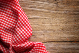 Fototapety Checkered tablecloth on wooden table