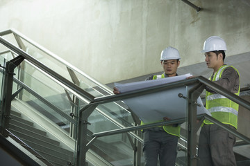 Two Asian industrial engineer's at work.