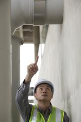 Asian industrial engineer at work