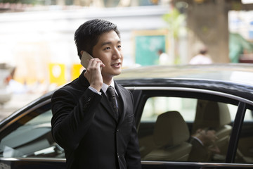 Chinese business man using a smartphone.