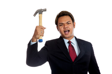 Aggressive Asian businessman angry hold a hammer