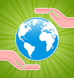 Caring hands with planet Earth