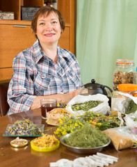 Smiling mature woman with  herbs