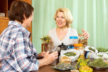 Two  women drinking herbal tea