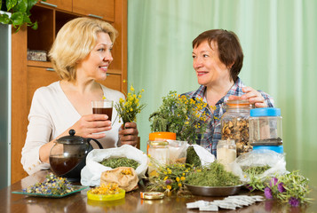 Two women brewing herbal tea