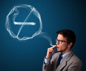 Young man smoking unhealthy cigarette with no smoking sign