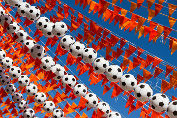 Orange flags and footballs during world cup 2014