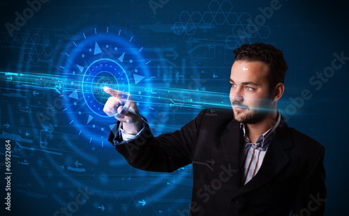 Handsome tech guy pressing high technology control panel screen
