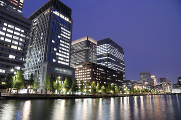 The city lights of Tokyo reflect off of the water