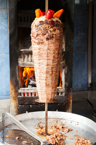 Shawarma meat on rotating spit - 65925423