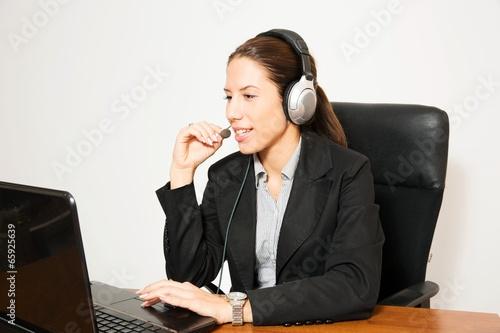 Business dressed female model in calling centar