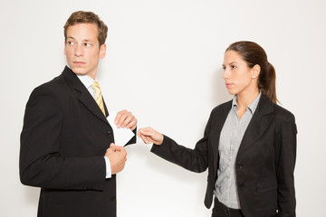 Business dressed male and female in different role plays.