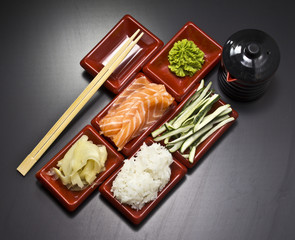 Ingredients for sushi: sliced salmon cucumber rice