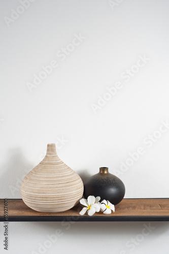 Vases decorated with Frangipani flower © 3532studio