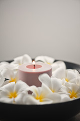Frangipani flower and candle decoration