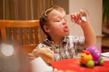 Young boy enjoying lunch poster