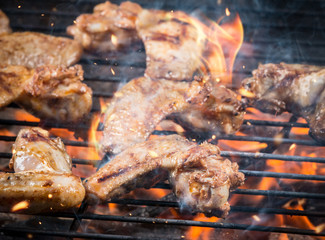 Grilled chicken wings on fire