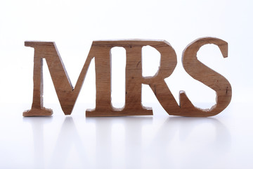 wood sign of missis (Mrs)
