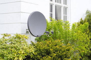 satelite is attached to the wall of the house