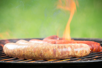 Grilled sausages on fire