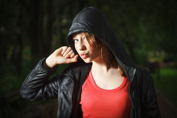 Teenage girl in sports hooded jacket