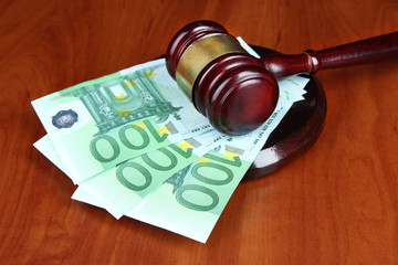 Gavel and money on table close-up