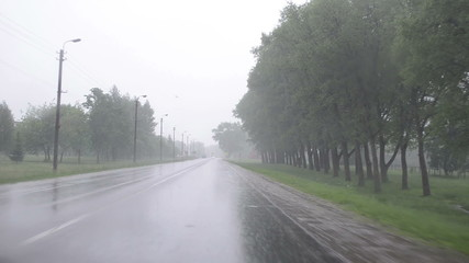 Huge rain fall on car automobile windscreen  driving on road