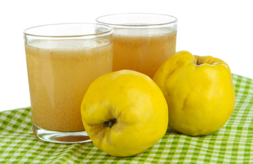 Sweet quince with juice on table on white background