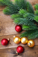Christmas fir tree  and decorations on wooden background