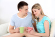 Loving couple sitting  with cups