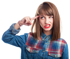 portrait of young woman doing crazy symbol gesture on white