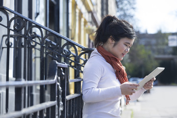 Young Asian woman using a tablet pc.