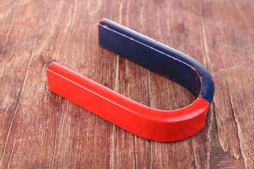 Magnet on color wooden background