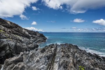 rocky shoreline of tropical volcanic island