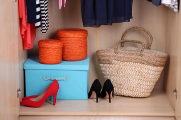 Female shoes and boxes in wardrobe