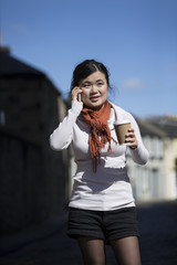 Chinese woman using smartphone outdorrs.