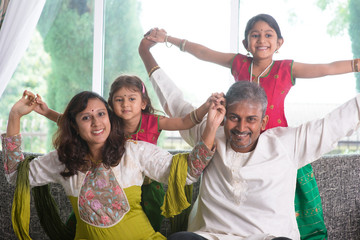 Happy Indian family at home