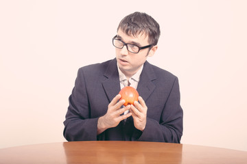 Worried businessman with apple