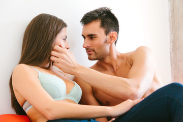 Young Casual Couple in Bed