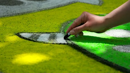 Painting with chalk on pavement