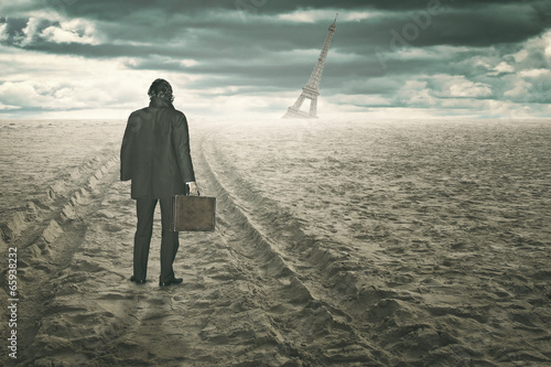 Businessman in a surreal and desert beach