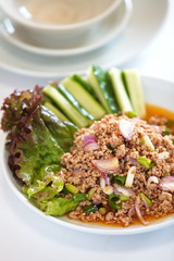 Spicy thai food pork minced salad and fresh vegetables