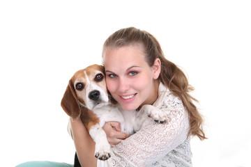 owner hugging pet Beage dog